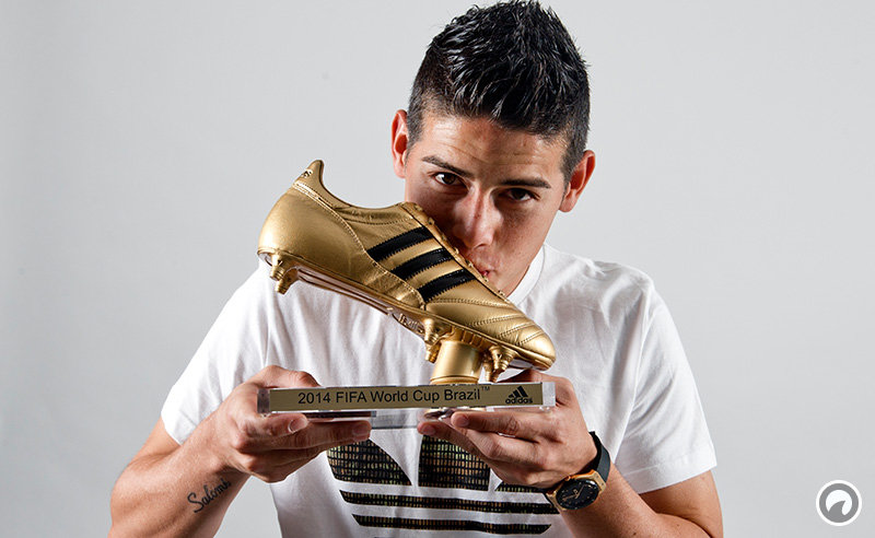 Footballer James Rodriguez receives his Golden Boot Trophy in recognition of scoring the most goals during the 2014 FIFA World Cup