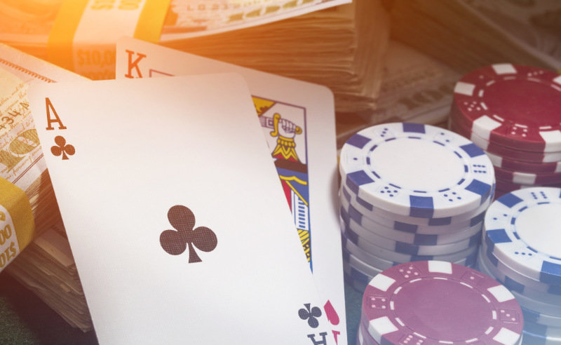 Poker cards, chips and cash.
