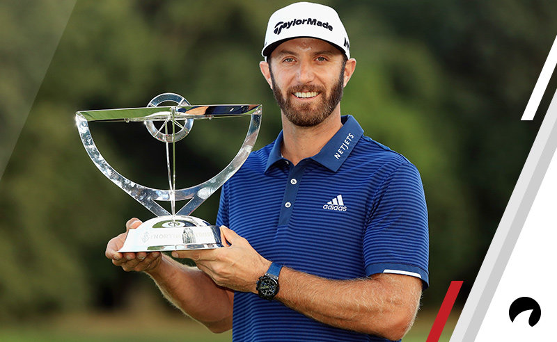 Dustin Johnson of the United States poses with the trophy after putting for birdie on the 18th green to defeat Jordan Spieth of the United States (not pictured) in a playoff to win The Northern Trust at Glen Oaks Club on August 27, 2017 in Westbury, New York.