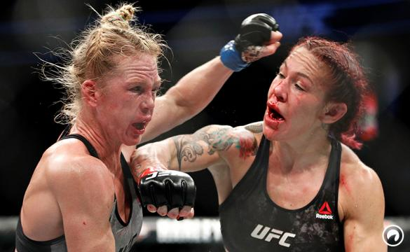 Cris Cyborg hits Holly Holm during a featherweight championship bout at UFC 219.