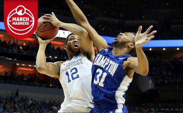 Karl-Anthony Towns of Kentucky goes up to the basket against a Hampton defender.