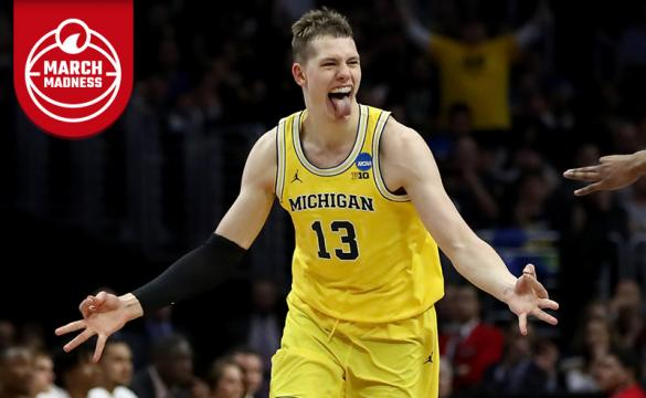 Moritz Wagner of the Michigan Wolverines celebrates after Wagner makes a three-pointer