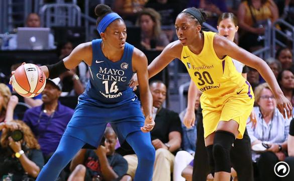 Temi Fagbenle of the Minnesota Lynx handles the ball against Nneka Ogwumike of the Los Angeles Sparks during a WNBA basketball game