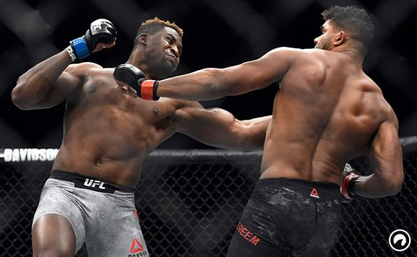 Francis Ngannou hits Alistair Overeem in the first round during a UFC 218 heavyweight MMA bout