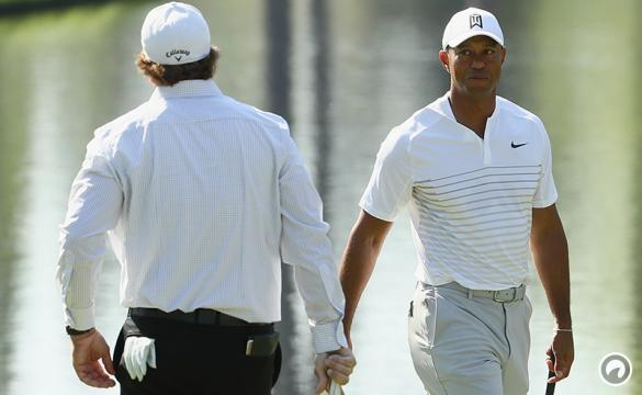Tiger Woods and Phil Mickelson of the United States talk during a practice round prior to the start of the 2018 Masters Tournament at Augusta National Golf Club on April 3, 2018 in Augusta, Georgia.