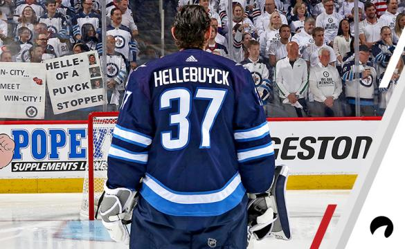 Goaltender Connor Hellebuyck #37 of the Winnipeg Jets looks on during the pre-game warm up prior to NHL action against the Vegas Golden Knights in Game One of the Western Conference Final during the 2018 NHL Stanley Cup Playoffs at the Bell MTS Place on May 12, 2018 in Winnipeg, Manitoba, Canada.