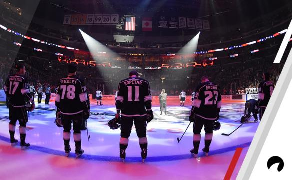 Ilya Kovalchuk #17, Daniel Brickley #78, Anze Kopitar #11, Dustin Brown #23 and Drew Doughty #8 of the Los Angeles Kings listen to the national anthem before the game against the Vegas Golden Knights at STAPLES Center on September 20, 2018 in Los Angeles, California.