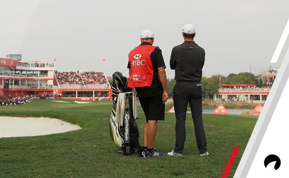 Justin Rose of England and caddie Mark Fulcher prepares to play a shot on the 18th hole during the final round of the WGC - HSBC Champions at Sheshan International Golf Club on October 29, 2017 in Shanghai, China.