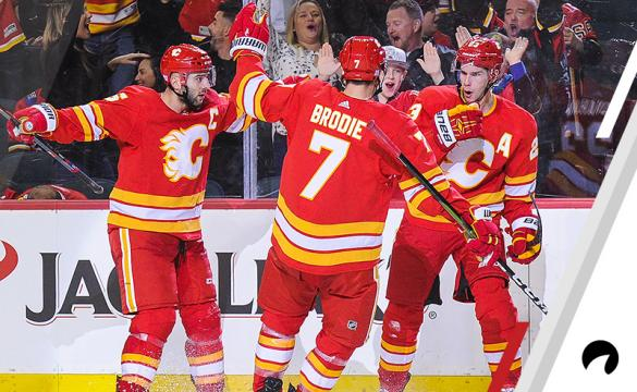 Sean Monahan #23 (R) of the Calgary Flames celebrates with his teammates after scoring against the Chicago Blackhawks to tie the game 3-3 during an NHL game at Scotiabank Saddledome on November 3, 2018 in Calgary, Alberta, Canada.
