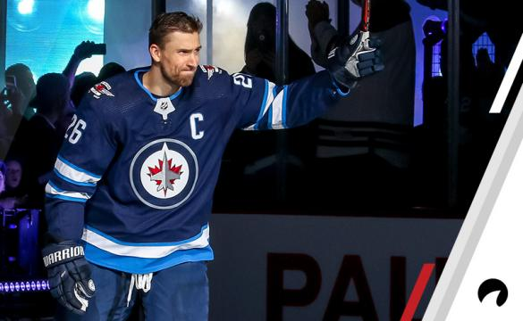Blake Wheeler #26 of the Winnipeg Jets raises his stick in salute to the fans during the player introductions prior to NHL action against the Los Angeles Kings at the Bell MTS Place on October 9, 2018 in Winnipeg, Manitoba, Canada.