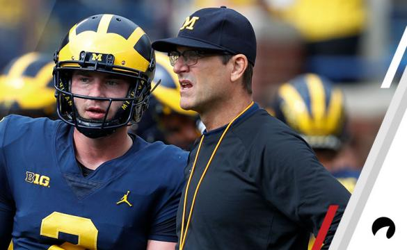 Michigan quarterback Shea Patterson (2) talks with head coach Jim Harbaugh before in the first half of an NCAA football game in Ann Arbor, Mich., Saturday, Oct. 6, 2018.