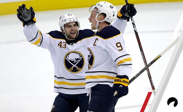 Buffalo Sabres' Jack Eichel (9) celebrates his game-winning overtime goal with Conor Sheary (43) during an NHL hockey game against the Pittsburgh Penguins in Pittsburgh, Monday, Nov. 19, 2018. The Sabres won 5-4 in overtime.