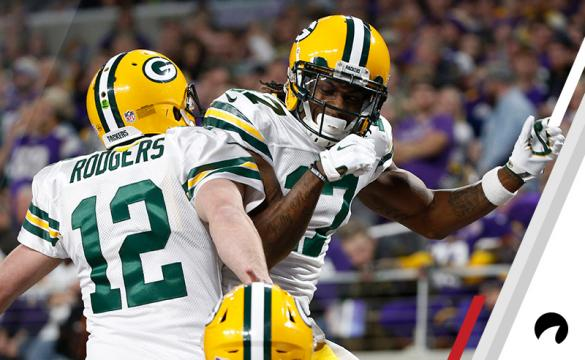 Green Bay Packers wide receiver Davante Adams (17) celebrates with Aaron Rodgers (12) after catching a 15-yard touchdown pass during the first half of an NFL football game against the Minnesota Vikings, Sunday, Nov. 25, 2018, in Minneapolis.