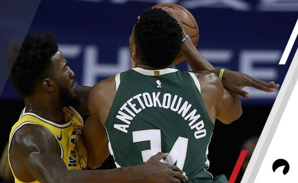 Giannis Antetokounmpo #34 of the Milwaukee Bucks is fouled by Jordan Bell #2 of the Golden State Warriors at ORACLE Arena on November 8, 2018 in Oakland, California. NOTE TO USER: