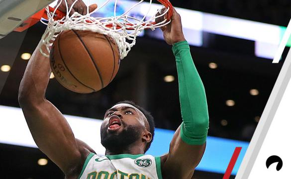 Boston Celtics' Jaylen Brown slam dunks the ball for two points in the first quarter. The Boston Celtics host the New York Knicks in a regular season NBA basketball game at TD Garden in Boston on Dec. 6, 2018