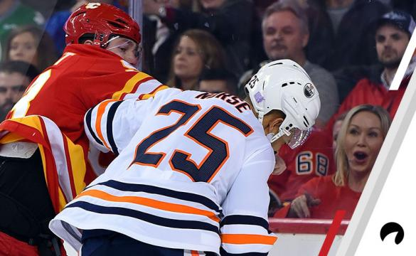 Fans react as Calgary Flames Left Wing Sam Bennett (93) and Edmonton Oilers Defenceman Darnell Nurse (25) fight during the first period of an NHL game where the Calgary Flames hosted the Edmonton Oilers on November 17, 2018, at the Scotiabank Saddledome in Calgary, AB