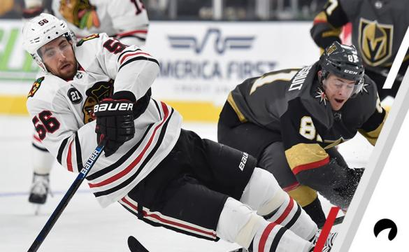 Jonathan Marchessault #81 of the Vegas Golden Knights trips Erik Gustafsson #56 of the Chicago Blackhawks during the first period at T-Mobile Arena on December 6, 2018 in Las Vegas, Nevada.