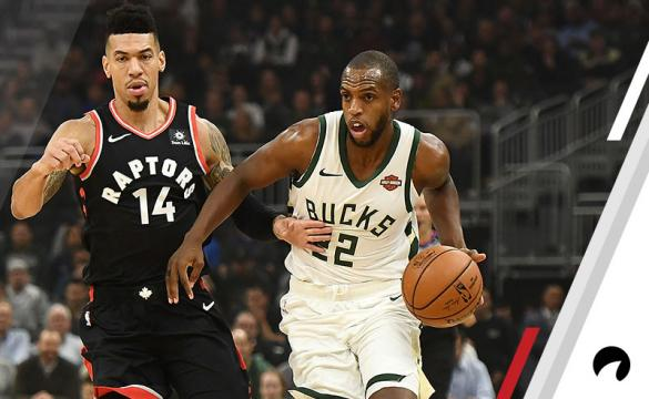 Khris Middleton #22 of the Milwaukee Bucks is defended by Danny Green #14 of the Toronto Raptors during a game at Fiserv Forum on October 29, 2018 in Milwaukee, Wisconsin