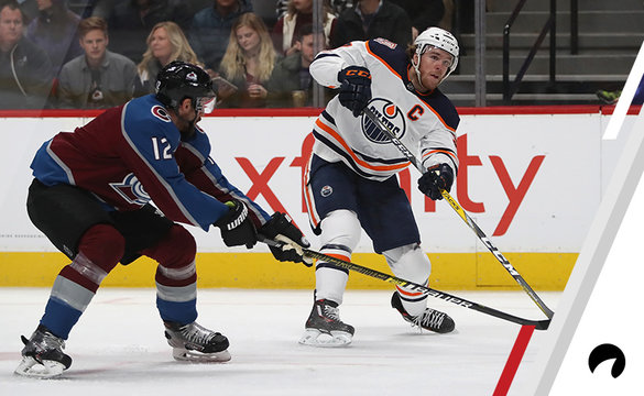 Connor McDavid #97 of the Edmonton Oilers fires a shot on goal against Patrik Nemeth #12 of the Colorado Avalanche in the first period at Pepsi Center on December 11, 2018 in Denver, Colorado