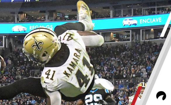 Alvin Kamara #41 of the New Orleans Saints attempts to leap over Eric Reid #25 of the Carolina Panthers during the fourth quarter at Bank of America Stadium on December 17, 2018 in Charlotte, North Carolina.