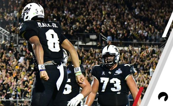 Darriel Mack Jr. #8 of the UCF Knights celebrates after running in a touchdown in the fourth quarter of the American Athletic Championship against the Memphis Tigers at Spectrum Stadium on December 01, 2018 in Orlando, Florida. The Knights won 56-41.