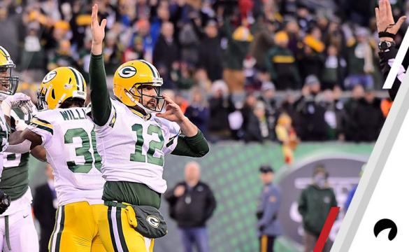 Aaron Rodgers #12 of the Green Bay Packers celebrates after scoring a 1 yard touchdown to put them ahead 38-35 against the New York Jets during the fourth quarter at MetLife Stadium on December 23, 2018 in East Rutherford, New Jersey.