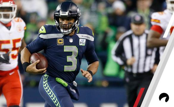Quarterback Russell Wilson #3 of the Seattle Seahawks rushes for a first down during the first quarter of the game against the Kansas City Chiefs at CenturyLink Field on December 23, 2018 in Seattle, Washington