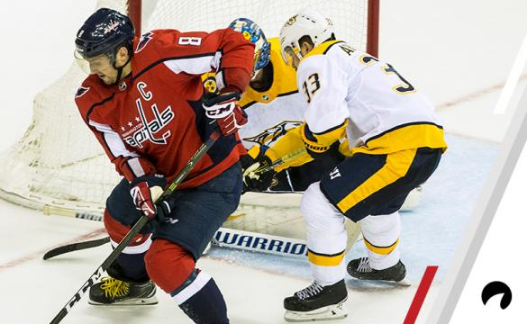 Nashville Predators center Nick Bonino (13) guards the goal behind Washington Capitals left wing Alex Ovechkin (8) during a NHL game between the Washington Capitals and the Nashville Predators on December 31, 2018, at Capital One Arena, in Washington D.C