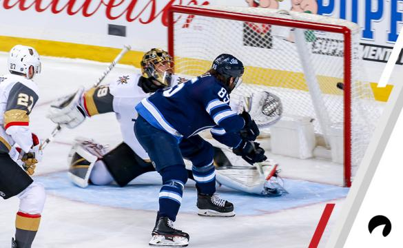 Mathieu Perreault #85 of the Winnipeg Jets backhands the puck past goaltender Marc-Andre Fleury #29 of the Vegas Golden Knights for a second period goal at the Bell MTS Place on January 15, 2019 in Winnipeg, Manitoba, Canada.
