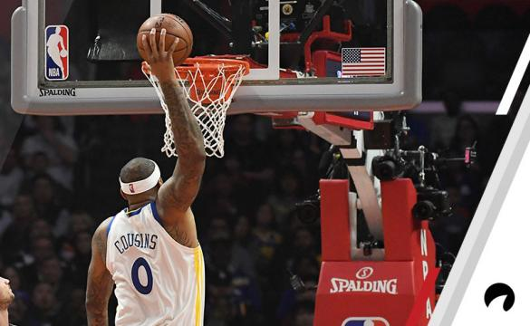 DeMarcus Cousins #0 of the Golden State Warriors scores a basket against Danilo Gallinari #8 of the Los Angeles Clippers during the first half at Staples Center on January 18, 2019 in Los Angeles, California