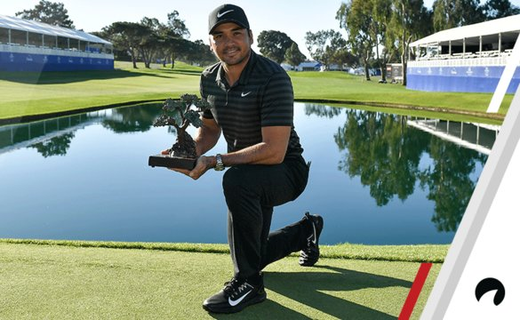 Jason Day of Australia poses with the trophy after the sixth playoff on the 18th hole to win the Farmers Insurance Open at Torrey Pines South on January 29, 2018 in San Diego, California