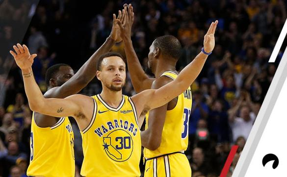 Kevin Durant #35, Stephen Curry #30 and Draymond Green #23 of the Golden State Warriors celebrate after a basket against the Portland Trail Blazers at ORACLE Arena on December 27, 2018 in Oakland, California