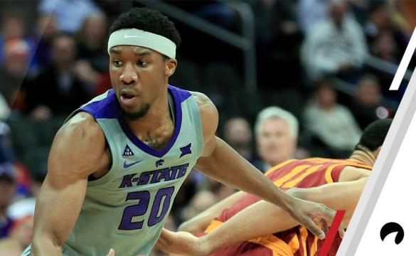 Kansas State forward Xavier Sneed (20) spins away from Iowa State guard Talen Horton-Tucker (11) during the first half of an NCAA college basketball game in the semifinals of the Big 12 Conference tournament in Kansas City, Mo.,
