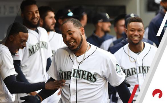 Edwin Encarnacion #10 of the Seattle Mariners celebrates in the dugout after hitting a home run in the third inning during a game between the Boston Red Sox and the Seattle Mariners at T-Mobile Park on Thursday, March 28, 2019 in Seattle, Washington.