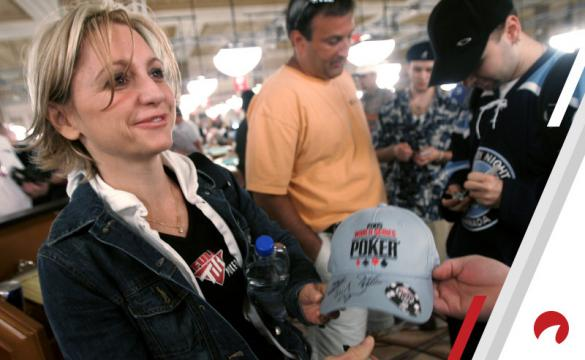 Poker pro Jennifer Harman signing a hat.