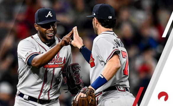ulio Teheran #49 of the Atlanta Braves and Dansby Swanson #7 celebrate an inning-ending play against the Colorado Rockies at Coors Field on April 8, 2019 in Denver, Colorado.