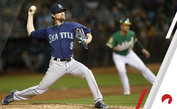 Mike Leake #8 of the Seattle Mariners pitches during the game against the Oakland Athletics at the Oakland Alameda Coliseum on August 31, 2018 in Oakland, California.