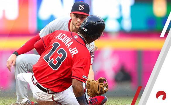 Ronald Acuna Jr. #13 of the Atlanta Braves is tagged out while attempting to steal second base by Trea Turner #7 of the Washington Nationals in the third inning during a game at SunTrust Park on July 19, 2019 in Atlanta, Georgia