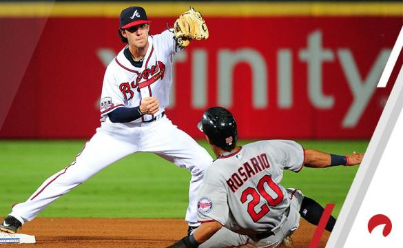 Dansby Swanson #2 of the Atlanta Braves forces out Eddie Rosario #20 of the Minnesota Twins at second base during the seventh inning at Turner Field on August 17, 2016 in Atlanta, Georgia.
