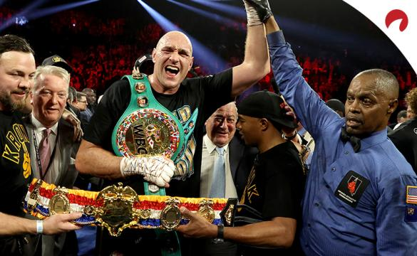 Tyson Fury celebrates with his WBC and Ring Magazine belts after his victory over Deontay Wilder.
