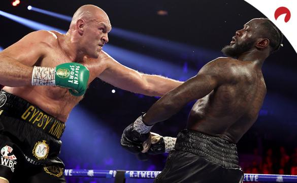 Tyson Fury (right) is favored in the Fury vs Wilder 3 odds.