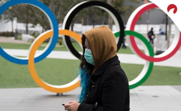 Woman with mask: how COVID-19 impacts the 2020 Summer Olympics Cancellation Odds