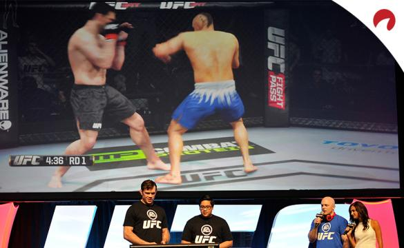 Forrest Griffin and fan playing UFC video game