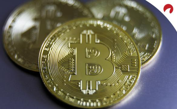 Three coins with the bitcoin logo on them