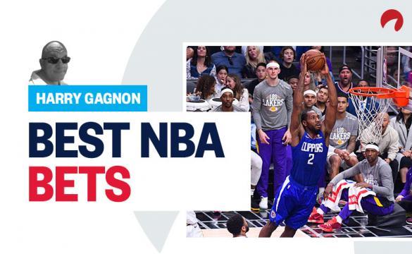 Los Angeles Clippers Forward Kawhi Leonard (2) goes up for a dunk as Los Angeles Lakers Forward LeBron James (23) looks on.