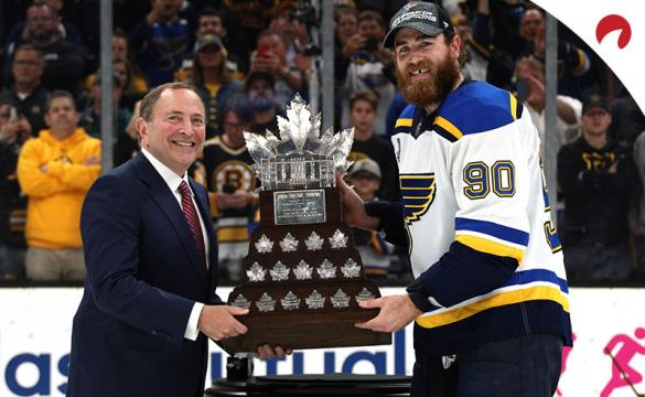 NHL Commissioner Gary Bettman presents Ryan O'Reilly #90 of the St. Louis Blues with the Conn Smythe Trophy.