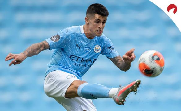 João Cancelo of Manchester City in action during the Premier League match between Manchester City and Norwich City.