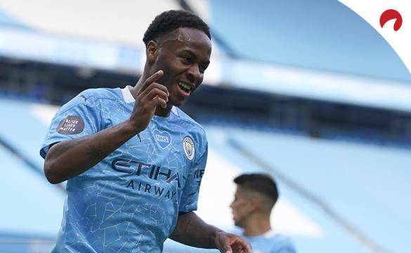 Raheem Sterling celebrating after scoring a goal