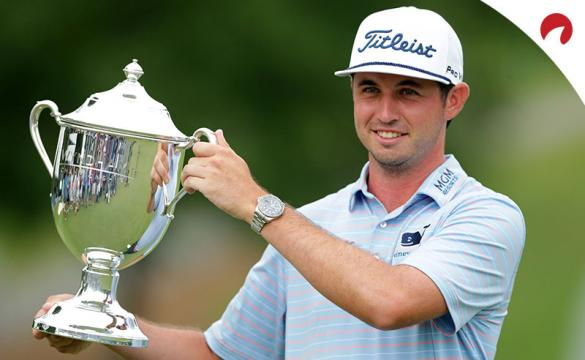 J.T. Poston celebrates with the trophy after winning the Wyndham Championship at Sedgefield Country Club.