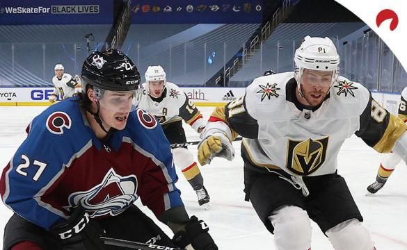 Ryan Graves #27 of the Colorado Avalanche and Jonathan Marchessault #81 of the Vegas Golden Knights skate in the second period of a Round Robin game during the 2020 NHL Stanley Cup Playoff.
